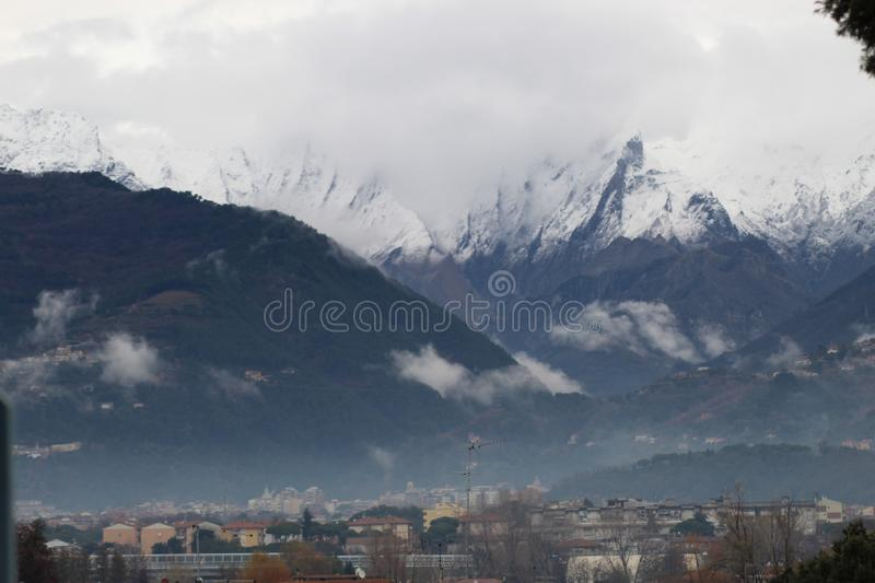 The snow on the beautiful mountains. This is the view of the Alps mountains. The snow has fallen on the mountains since a few days. This picture was taken at the royalty free stock images