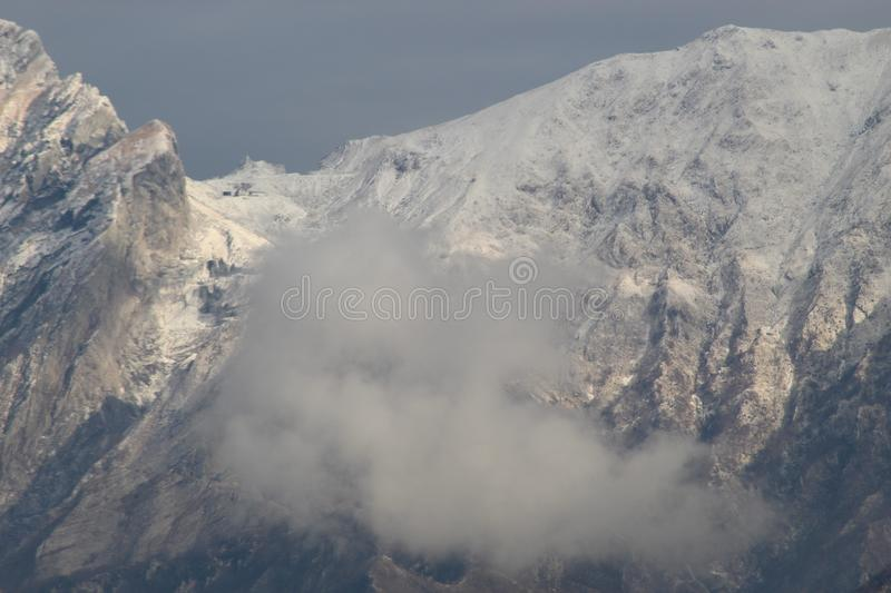 The snow on the beautiful mountains. This is the view of the Alps mountains. The snow has fallen on the mountains since a few days. This picture was taken at the royalty free stock photography
