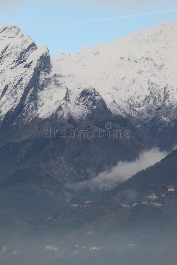 The snow on the beautiful mountains. This is the view of the Alps mountains. The snow has fallen on the mountains since a few days. This picture was taken at the stock photography