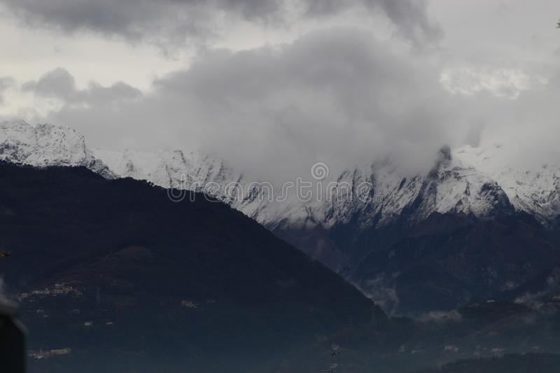 The snow on the beautiful mountains. This is the view of the Alps mountains. The snow has fallen on the mountains since a few days. This picture was taken at the stock image