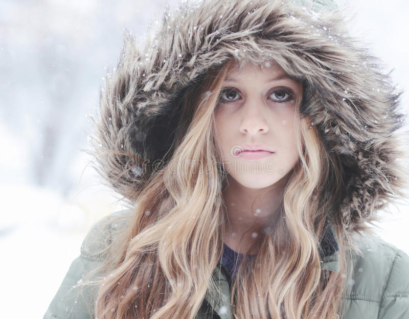 Snow Beauty. Beautiful teenager girl in the cold winter snow