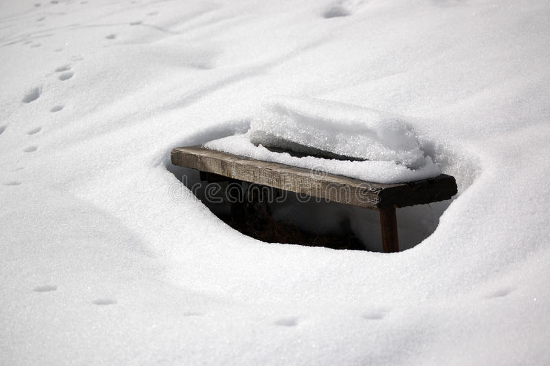 Snow and bench stock images