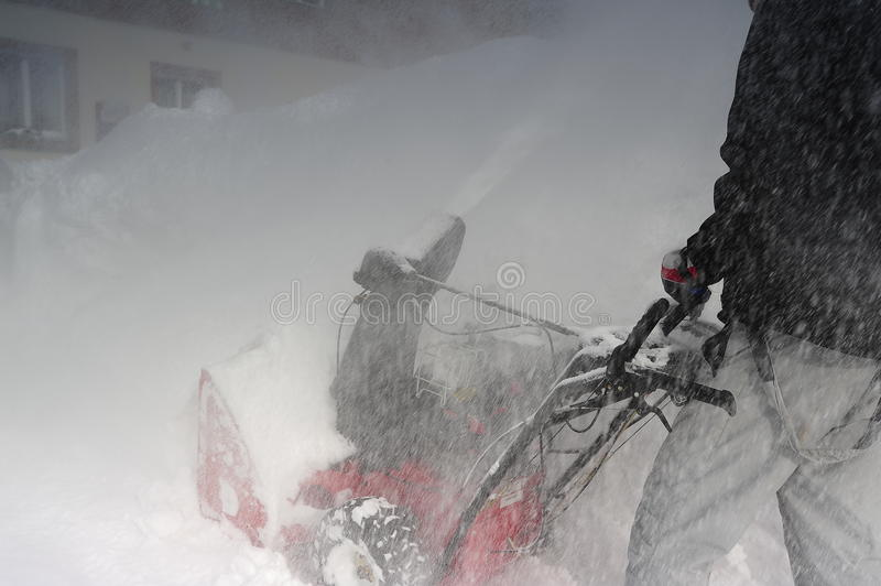 Snow blower at work stock images