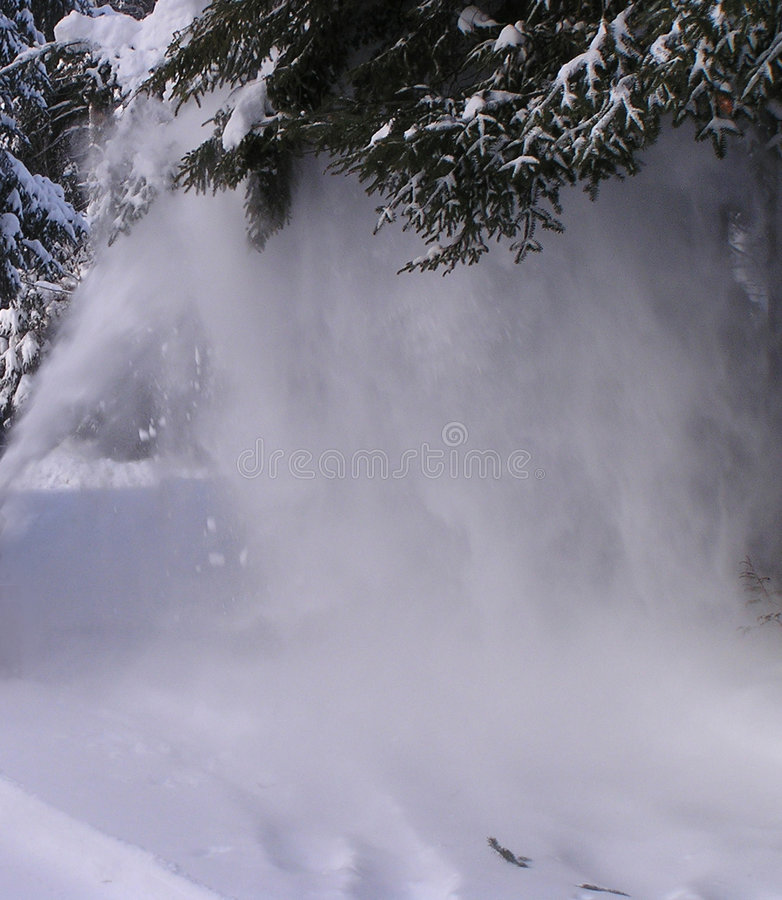 Snow blowing royalty free stock photo