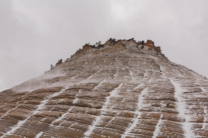 Snow blowing across Checkerboard mesa in Zion nat. park stock images