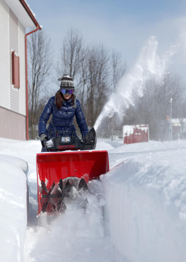 Snow Blowing Girl Royalty Free Stock Photos