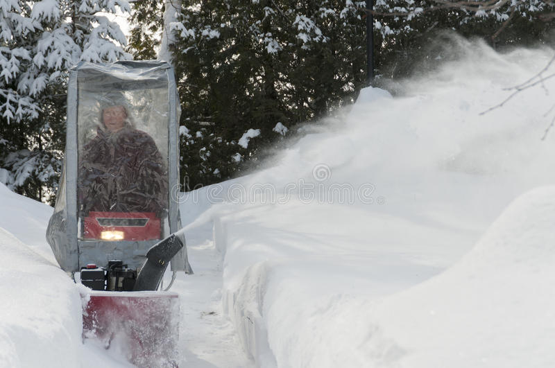 Snow blowing senior royalty free stock photography