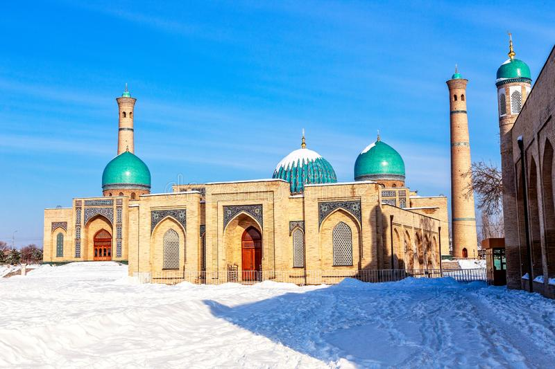 Snow, blue domes and ornated mosques and minarets of Hazrati royalty free stock photography