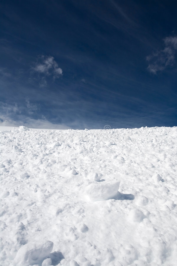 Snow and blue sky with clouds. Beautiful blue sky and white snow royalty free stock photos