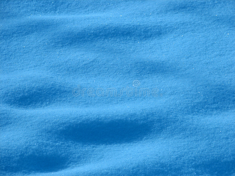 Snow Blue Tint. Snow on the ground covering footprints and tracks, sparkling in sunlight. Blue tint added stock photos