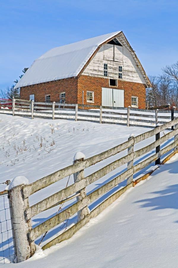 Snow Brick Barn royalty free stock images