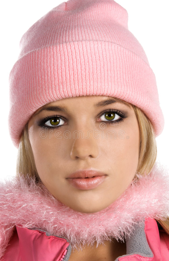 Snow Bunny. Beautiful young blond woman dressed in a pink hat, scarf and vest ready to brave the cold chill of winter