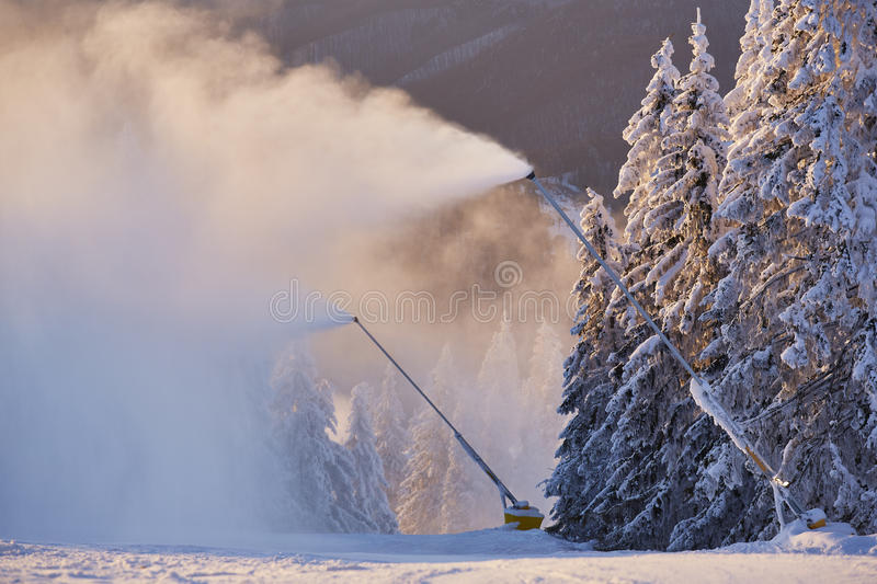 Snow cannons. Making artificial snow on a ski slope in Poiana Brasov winter resort, Romania stock images