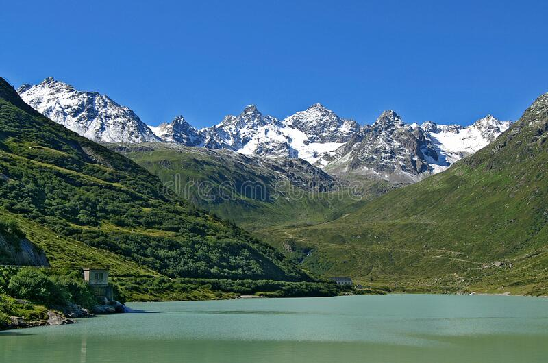 Snow capped Austrian Alps with lake royalty free stock photo