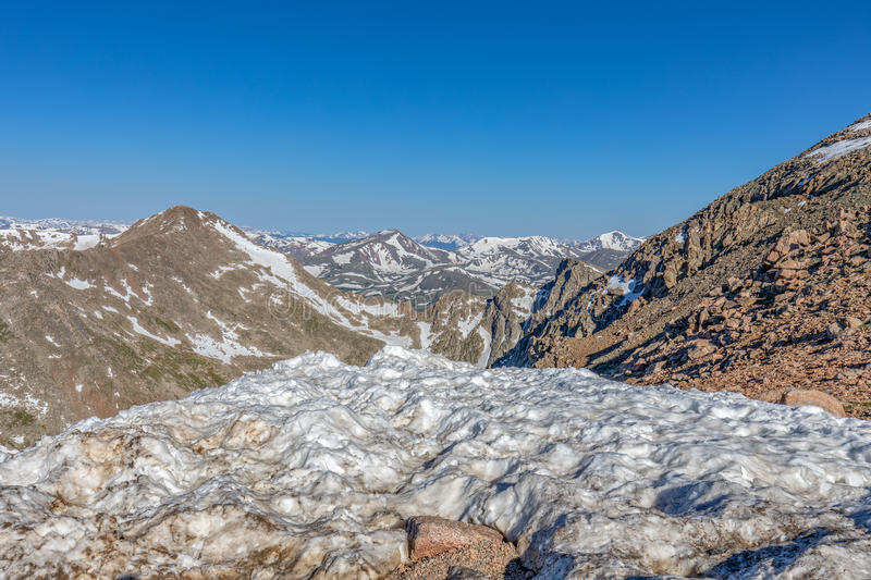 Snow Capped Colorado Rockies. The snow capped Colorado rockies in summer royalty free stock photography