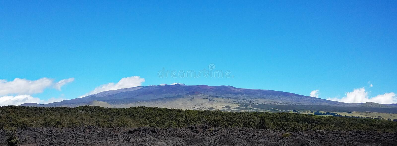 Snow-Capped Mauna Kea Volcano on a Clear Day stock photos