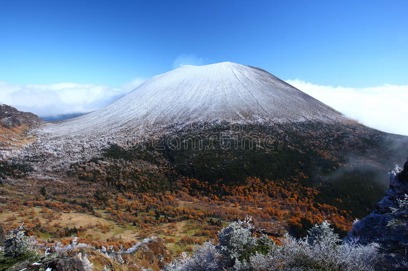 Snow capped mountain. Snow capped Mt.ASAMA in japan royalty free stock images