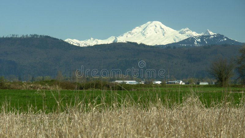 Snow Capped Mountain Mt. Baker. Mt. Baker viewed from Abbotsford, British Columbia stock image