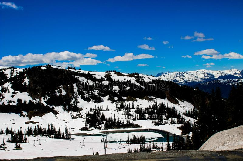 Snow capped mountain view from Whistler, Canada stock photo