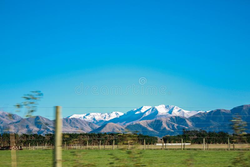 Snow capped mountains and hills in Ashburton Lakes District, South Island, New Zealand stock photo