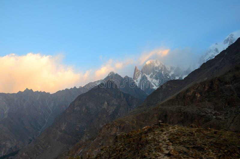 Snow capped mountains in Hunza Valley at sunrise Gilgit-Baltistan Pakistan. Hunza, Pakistan - September 30, 2016: Snow capped mountains at sunrise in Pakistan`s stock photo
