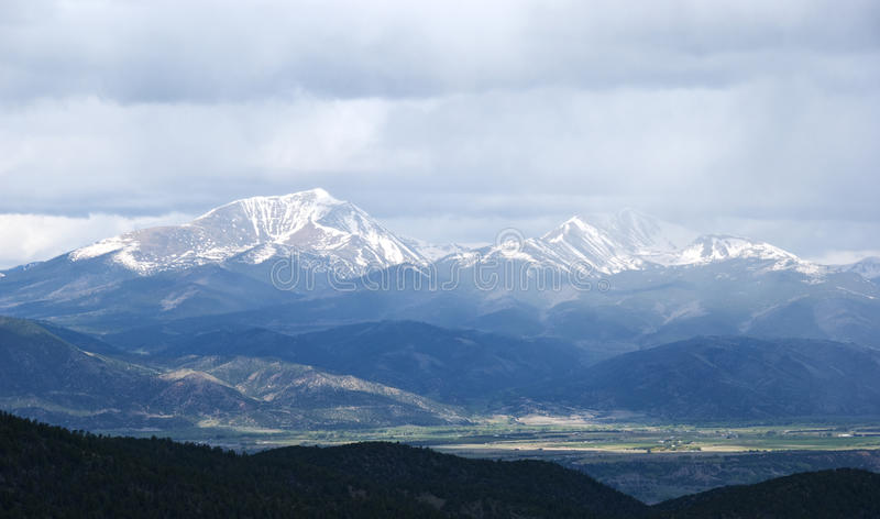 Download Snow Capped Mountains Shrouded In Storm Clouds Stock Image - Image: 16324729