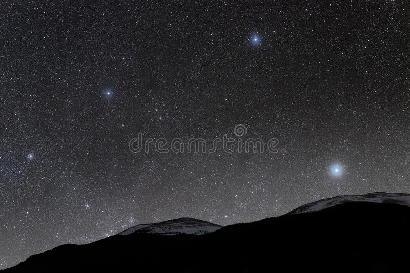 Snow Capped Mountains in the Starlight royalty free stock photos
