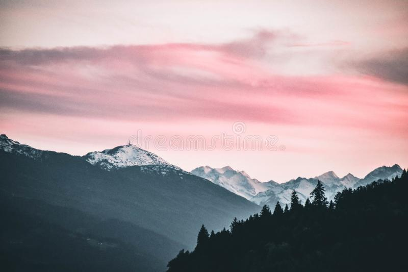 Snow Capped Mountains Under the Cloudy Skies stock photos