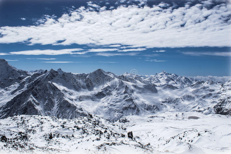 Snow-capped peaks royalty free stock photo
