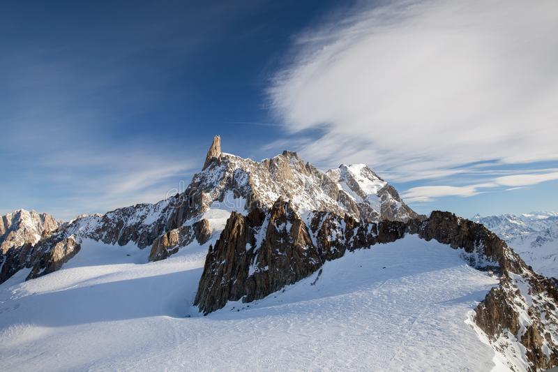 Snow-capped peaks of mountains in clear weather. Dent du Geant, Mont Blanc massif, Italy stock image