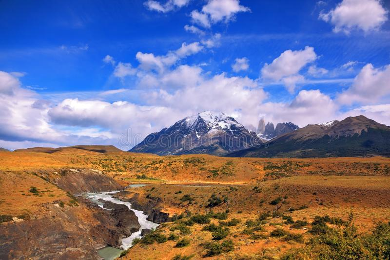 The snow caps on the high mountains. Horseshoe Paine. The national park Torres del Paine, Patagonia, Chile. Paine river bends in a horseshoe shape around the stock photo