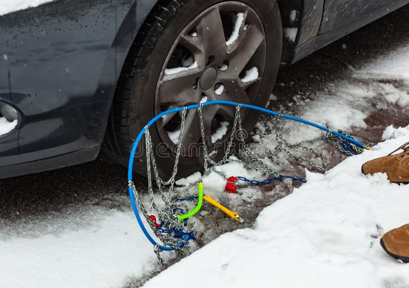 Snow chains near the car tire. stock images