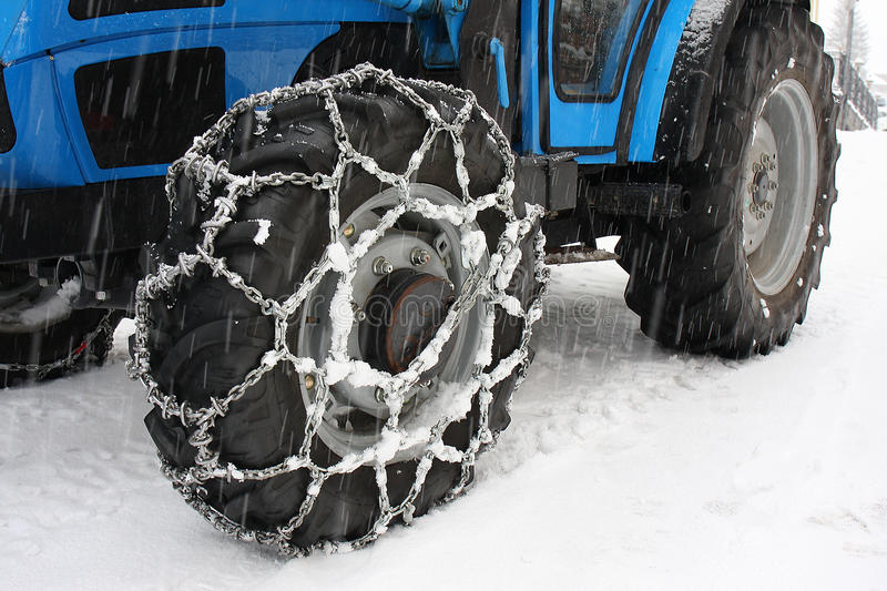 Snow chains tractor wheels royalty free stock images