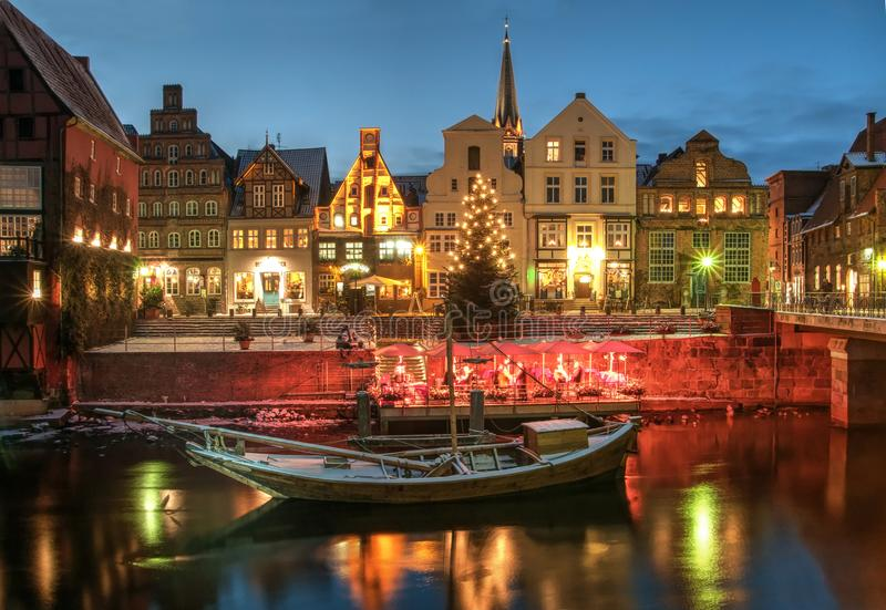 Snow and Christmas scenery by night, Lüneburg. stock photo