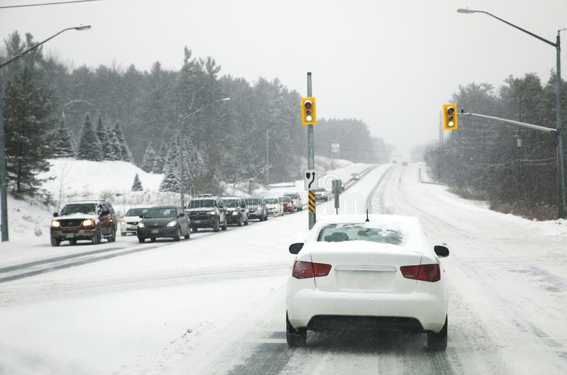 Snow in the city. Driving in severe weather conditions stock images
