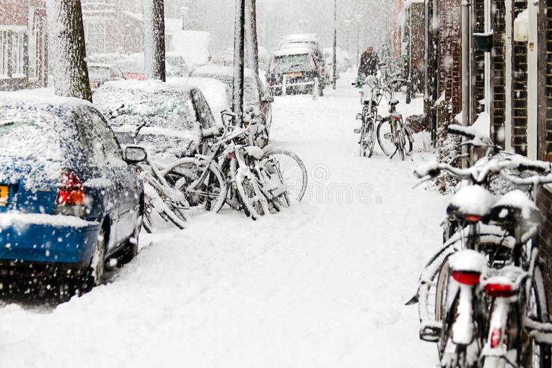 Snow in the city - snowstorm, streetview, bikes royalty free stock photography