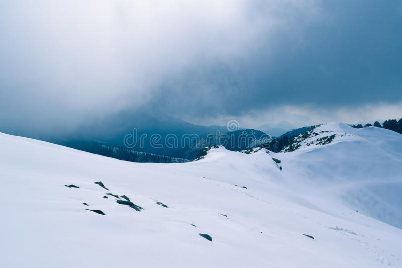 Snow cladded mountains of Dainkund in Dalhousie Himachal Pradesh. Mountains near Dainkund receives heavy snowfall during winter this turns whole panorama into stock image
