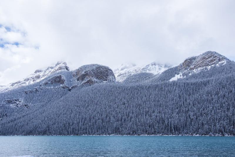 Snow clouds in the mountains at Lake Louise. Lake Louise having some fresh snowfall in the mountains royalty free stock images
