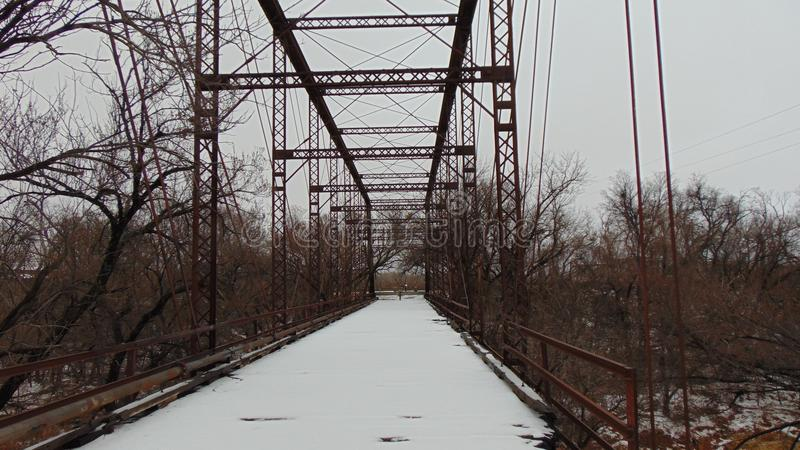 1917 Snow Covered Abandoned Bridge. Abandoned 1917 Bridge Over Wichita River Covered With Snow and Ice, North Texas stock photography