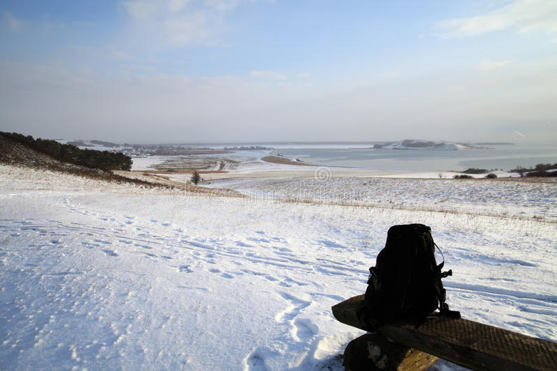 Snow covered beach. Scenic view of snow covered beach with ocean in background stock photography