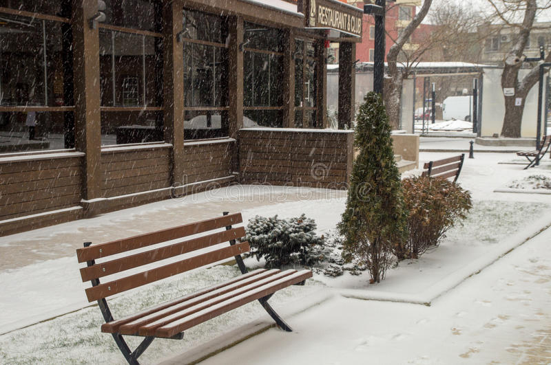 Snow-covered bench in the winter of Pomorie, Bulgaria stock photography