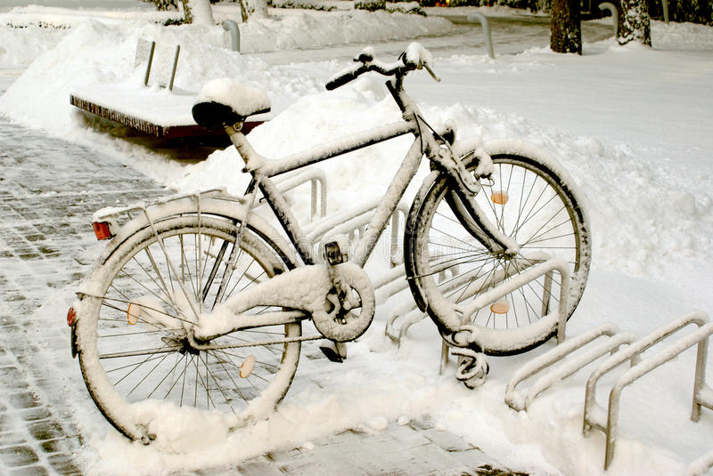 Snow covered bicycle royalty free stock photo