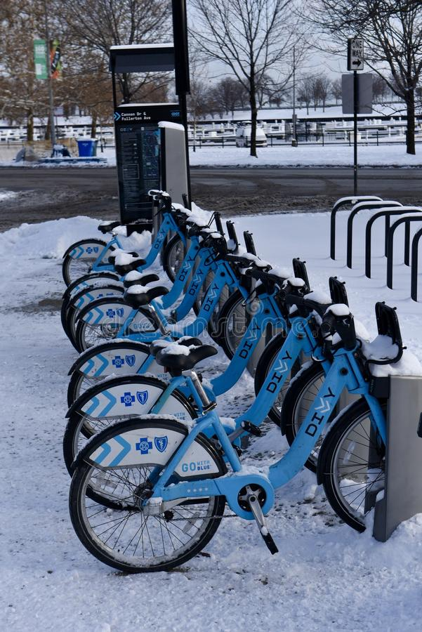 Snow Covered Bikes stock photo