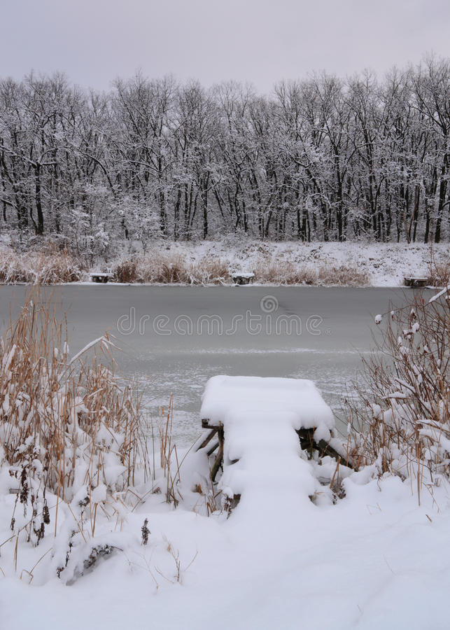 Snow-covered bridge. Beautiful winters morning landscape with the river stock photos