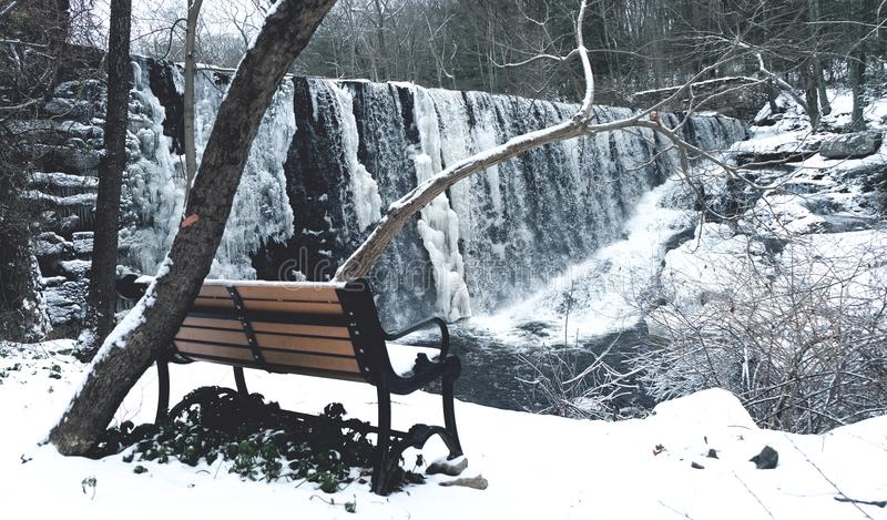 Snow Covered With Brown and Black Steel Couch stock photography