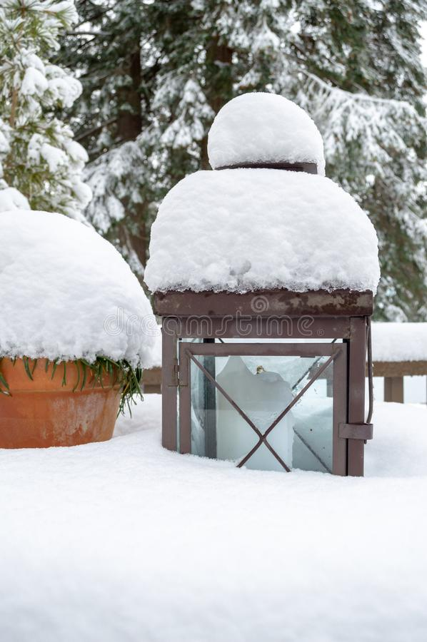 Snow -covered Candle and Terracotta Pot royalty free stock images