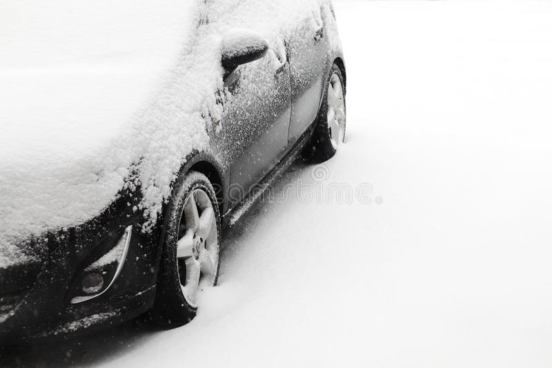 Snow covered car. Snow covered in car adverse weather conditions with copy space royalty free stock photos
