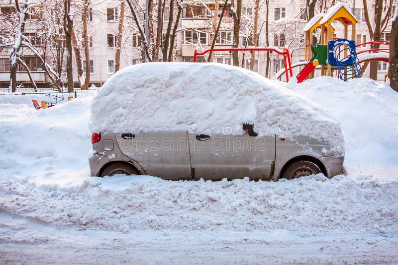 Snow covered car royalty free stock image