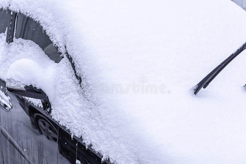 Snow covered car. Snowdrift of snow by car. Car standing in snow. Winter, snow, car in snowdrift stock photography