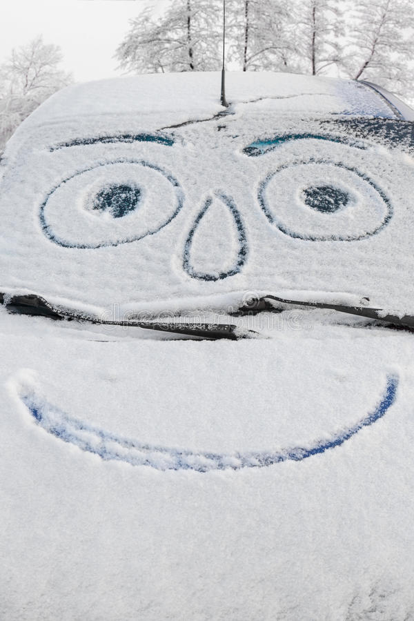 Free Snow Covered Car With Smiley Stock Images - 82136784